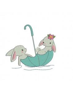 Motif de broderie machine lapins dans un parapluie