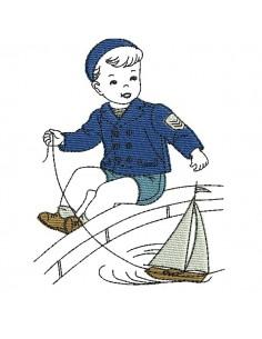 Motif de broderie machine garçon avec son bateau