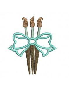 Motif de broderie machine pinceaux  avec un noeud appliqué
