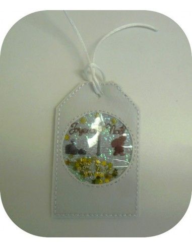 Motif de broderie machine  étiquette  boule de noël joyeux noël en mylar et en relief  ITH