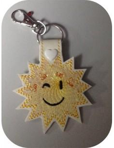 Motif de broderie machine porte clé soleil en mylar  ITH