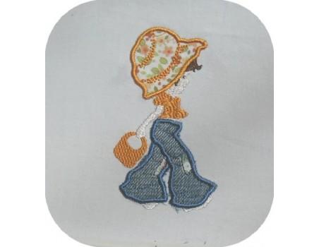 Motif de broderie fillette au sac