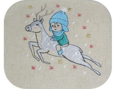 Motif de broderie machine garçon sur un renne
