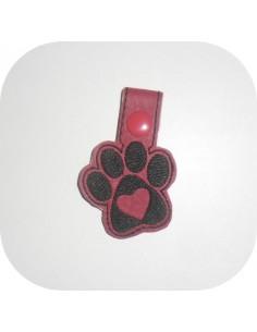 Motif de broderie machine porte clé patte de chien ou chat   ITH