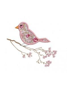 Motif de broderie oiseau sur une branche