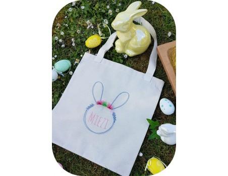 Motif de broderie machine  lapin personnalisable avec ses  fleurs et pompons en 3D