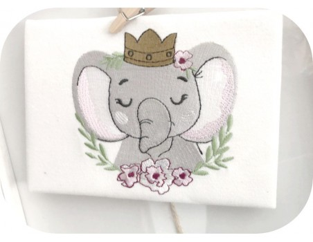 machine embroidery design sleeping crowned elephant with  frame flowers