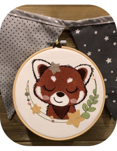 machine embroidery design sleeping red panda with star
