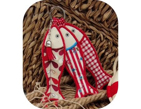 machine embroidery design ith sardines key ring