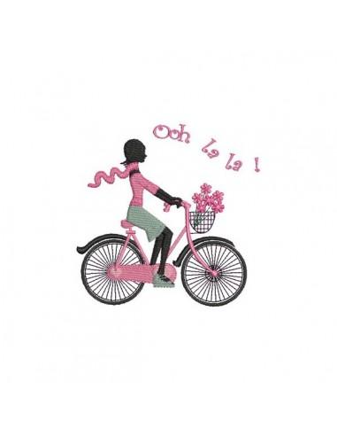 Motif de broderie machine Paris  silhouette femme Parisienne à vélo