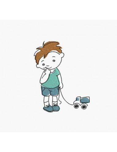 Motif de broderie machine garçon avec son camion