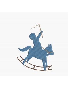 Motif de broderie machine garçon sur un cheval à bascule
