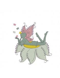 Motif de broderie machine fée allongée sur fleur