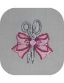 Motif de broderie machine ciseaux avec noeud
